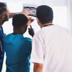 doctors looking at xray of injury